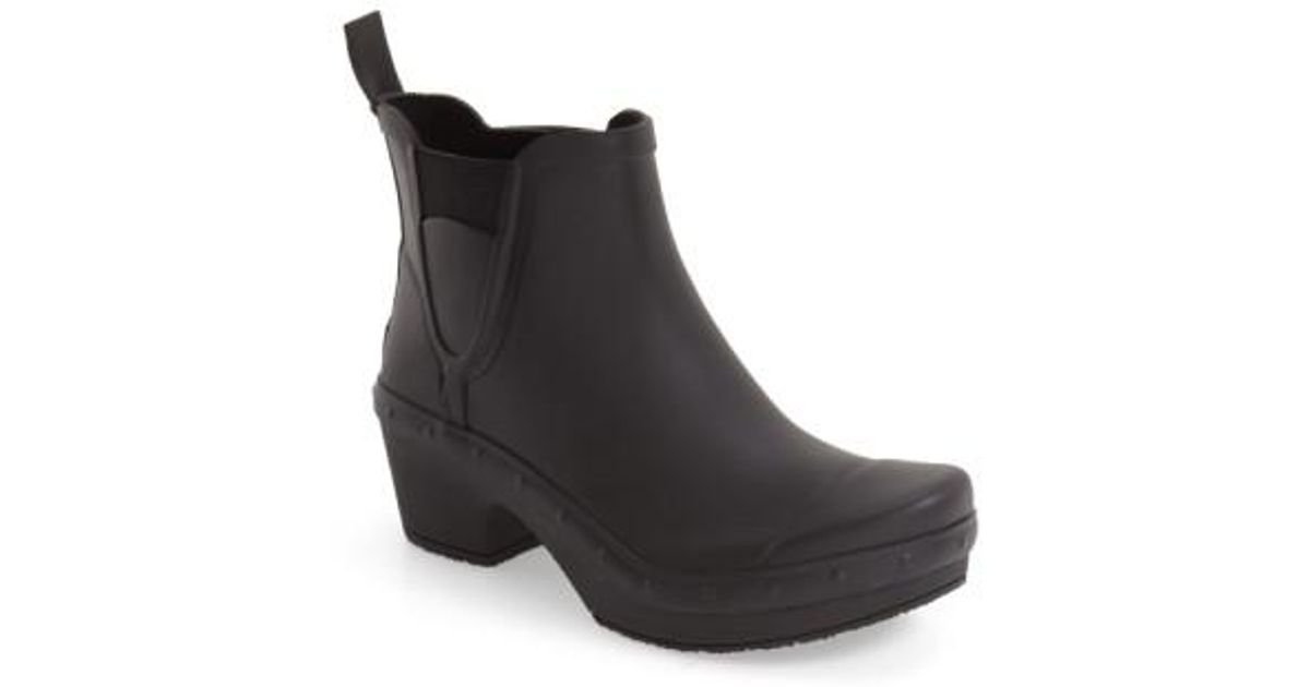 dansko rosa chelsea rain boots in black lyst. Black Bedroom Furniture Sets. Home Design Ideas