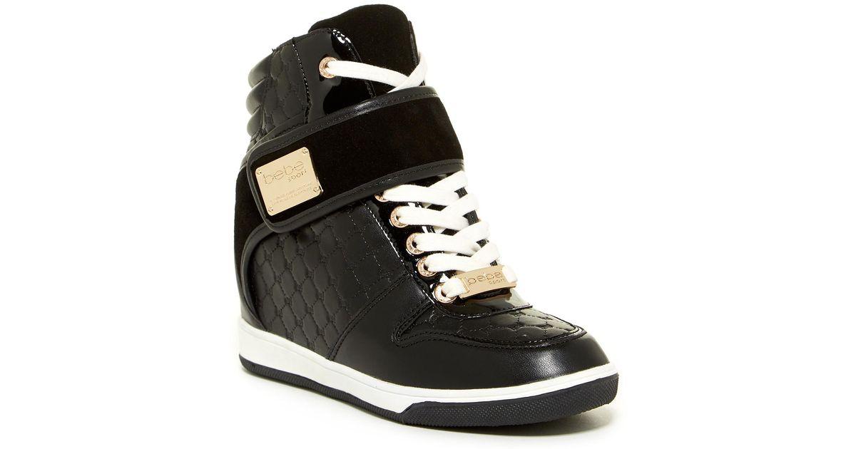 dcfc93c9be1 Lyst - Bebe Colby Wedge Sneakers in Black