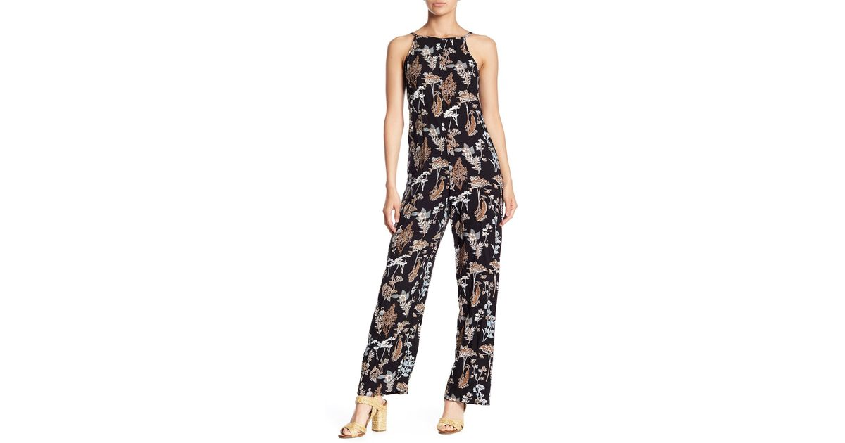 9eb2ece9c255 Lyst - Angie Floral Print Square Neck Jumpsuit in Black