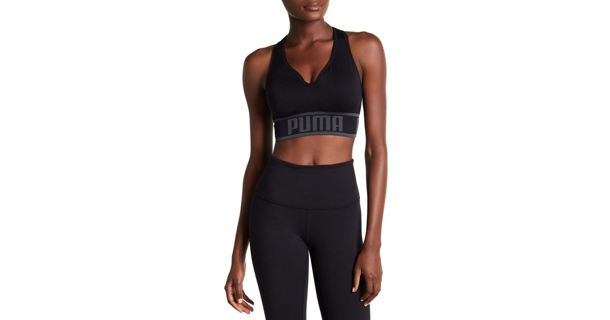 1f6bc012118 Lyst - PUMA Seamless Apex Sports Bra in Black