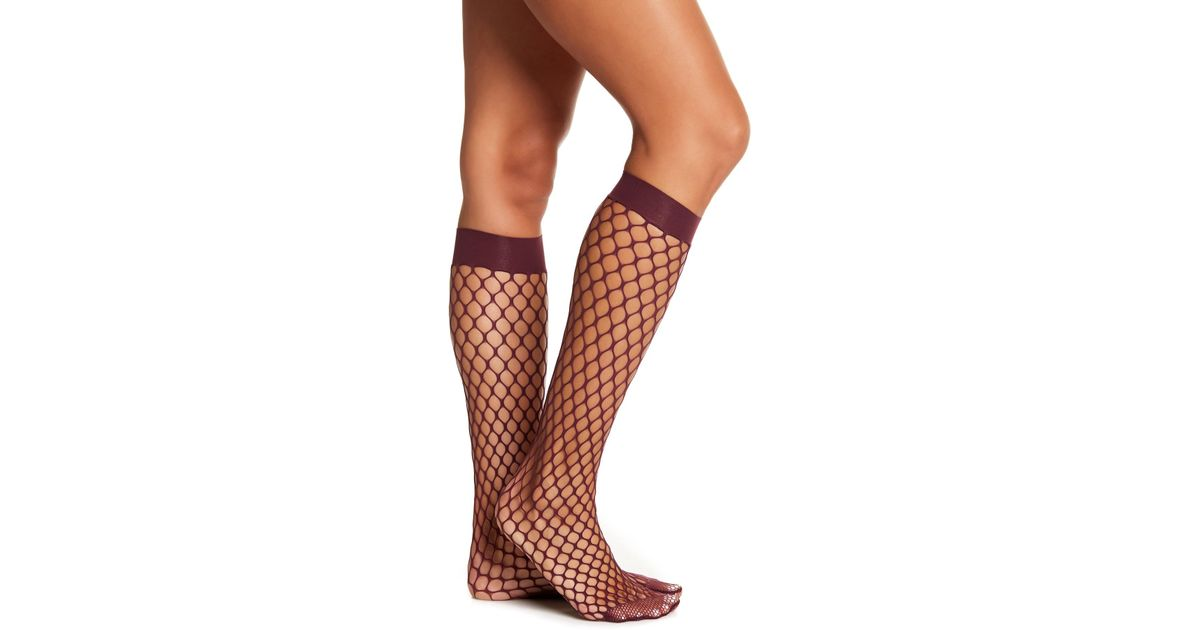 c6afd048a Lyst - Wolford Madeline Fishnet Knee High Socks