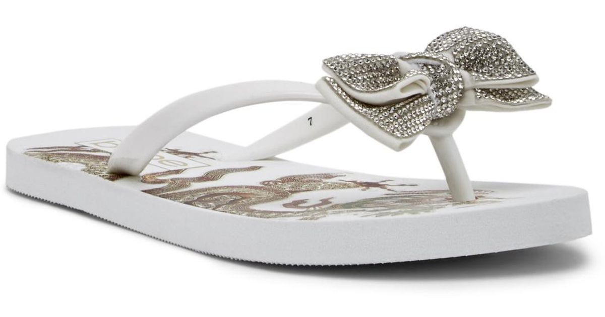 2927bce94187b Lyst - Bebe Addie Crystal Bow Flip Flop in White