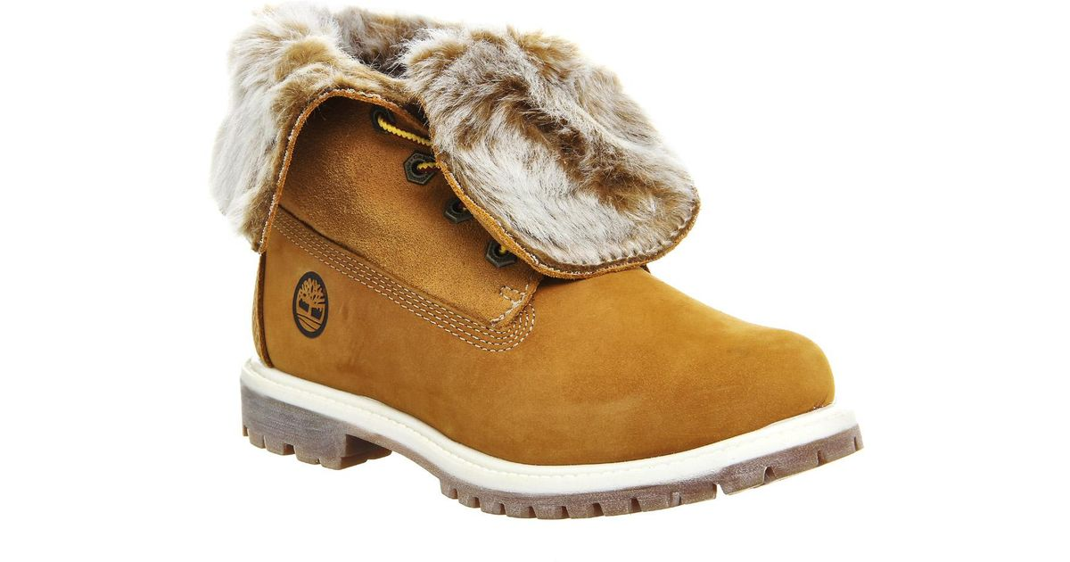 92028e3a50b5 Lyst - Timberland Fur Fold Down Boots in Natural