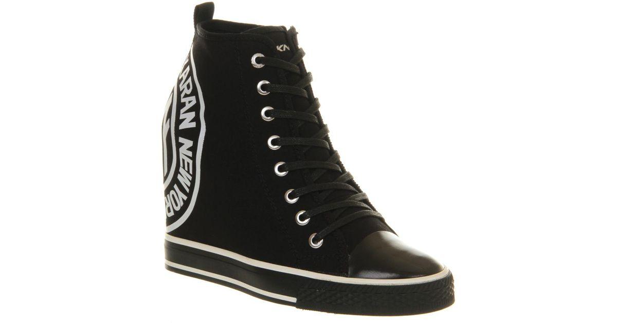26e88a6b488a Lyst - DKNY Grommet Wedge Sneaker in Black