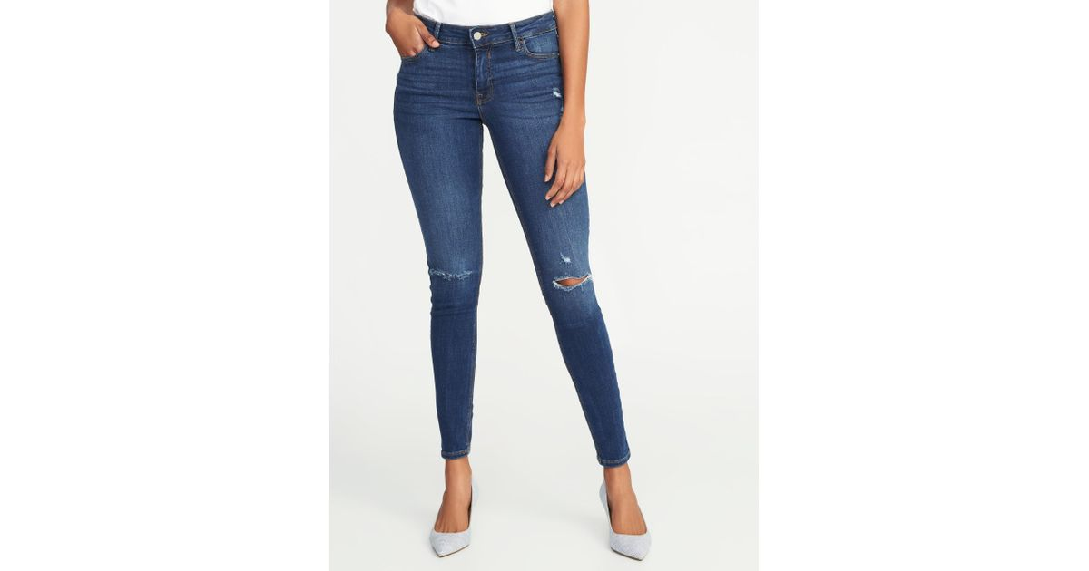 4d736acb697 Lyst - Old Navy Mid-rise Distressed Rockstar Super Skinny Jeans in Blue