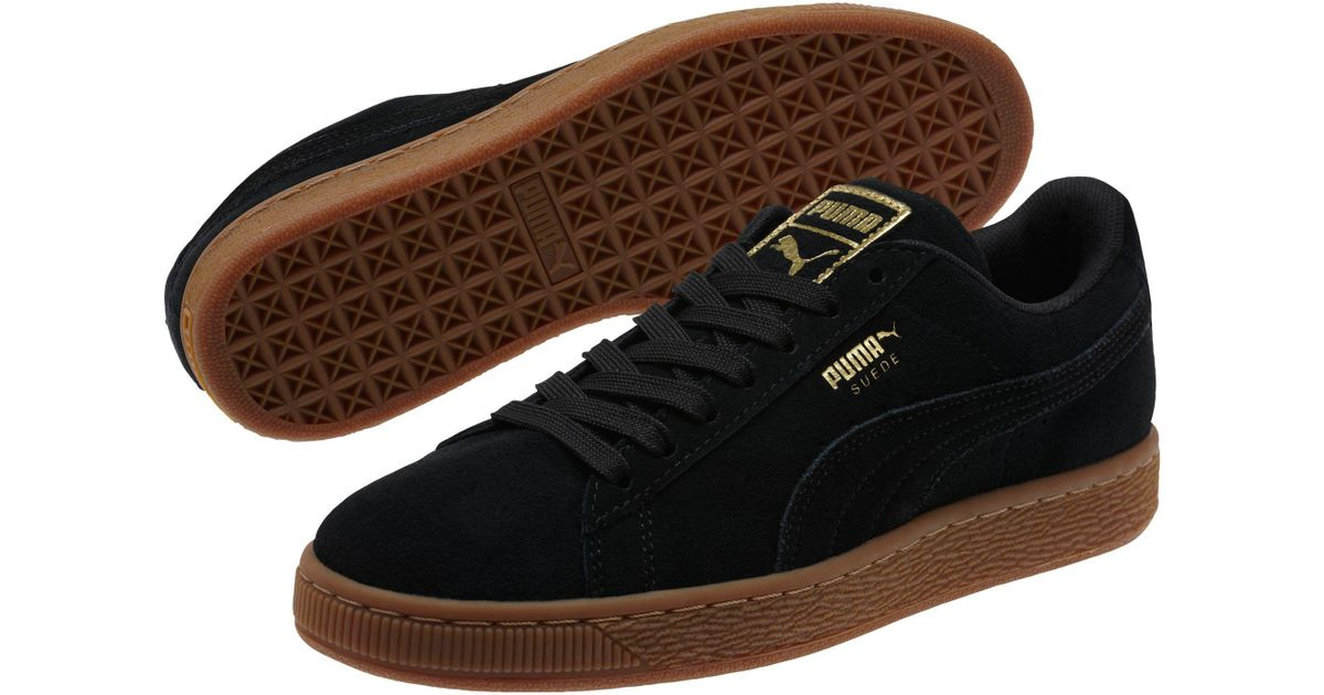 6a446a214b0 ... clearance lyst puma suede classic gold womens sneakers in black 8aed9  2bc21