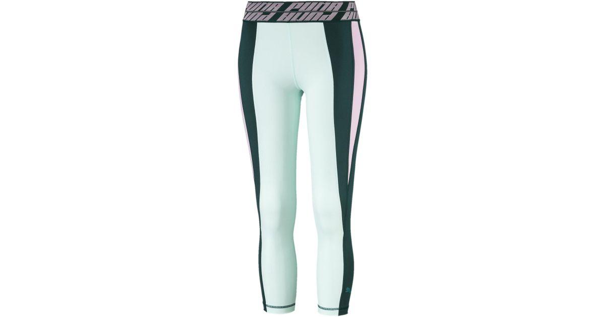 237464c4cf PUMA - Green Own It Women's 3/4 Leggings - Lyst