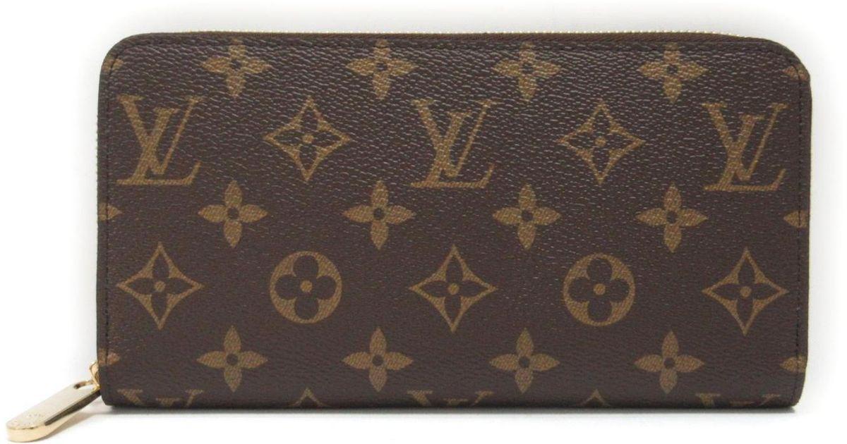f67dba2f1b87 Lyst - Louis Vuitton Monogram Brown Fuchsia Zip Around Zippy Wallet M41895  in Red