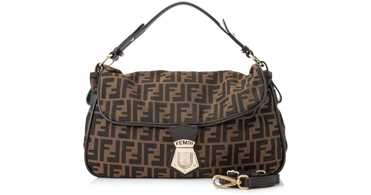 164fe3c882e ... lxrandco guarantees the authenticity of this vintage fendi baguette  shoulder bag. crafted in zucca wholesale lyst fendi pre owned zucca sling  bag in ...