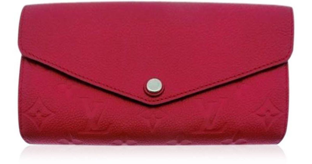 9b15bbab51d2 Lyst - Louis Vuitton Authentic Monogram Empreinte Cherry M61181 Sarah  Wallet 17030256ck in Red