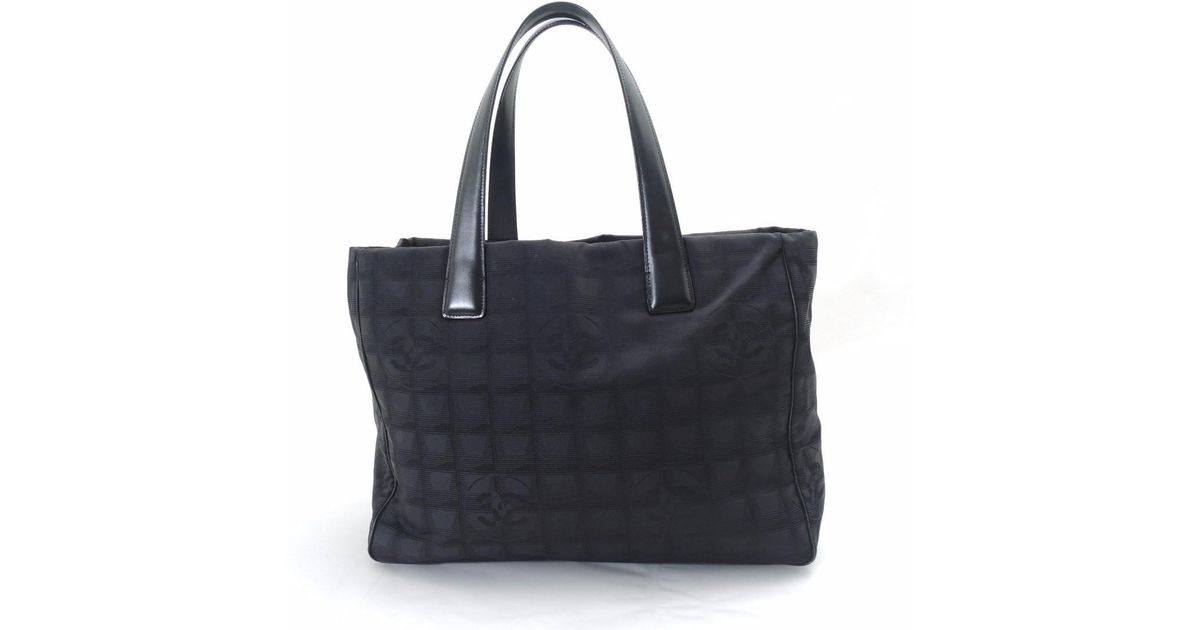 7a75e227ed1 Lyst - Chanel Nylon Jacquard New Travel Line Mm Tote Bag in Black
