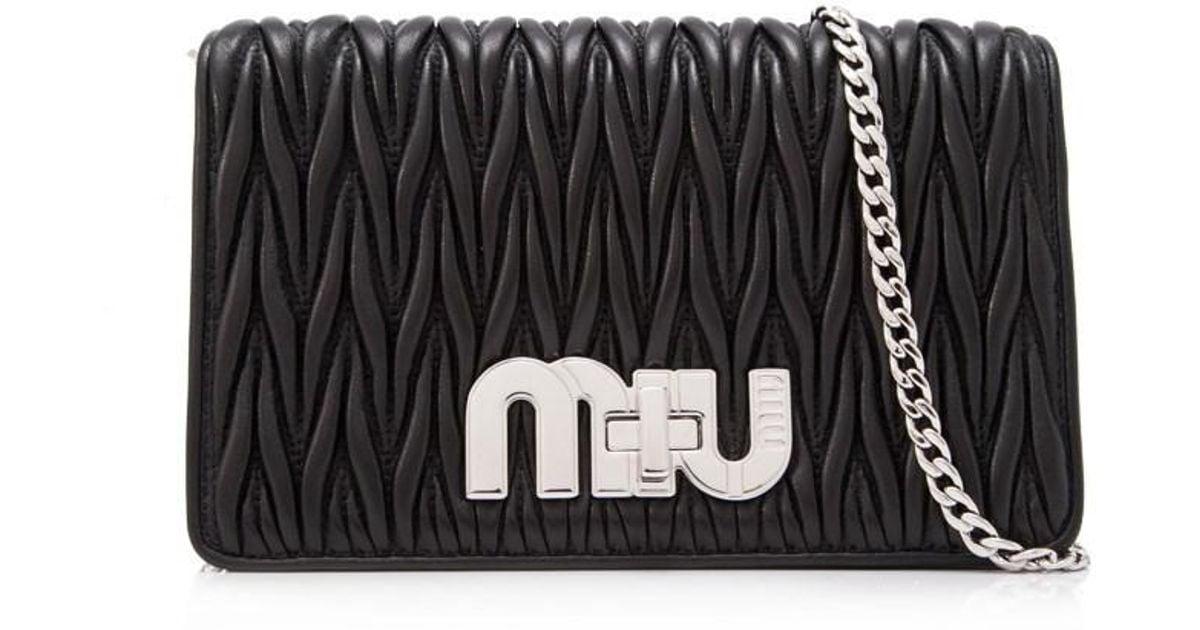 6193329baa49 Lyst - Miu Miu Matelasse Miu Logo Pochette in Black