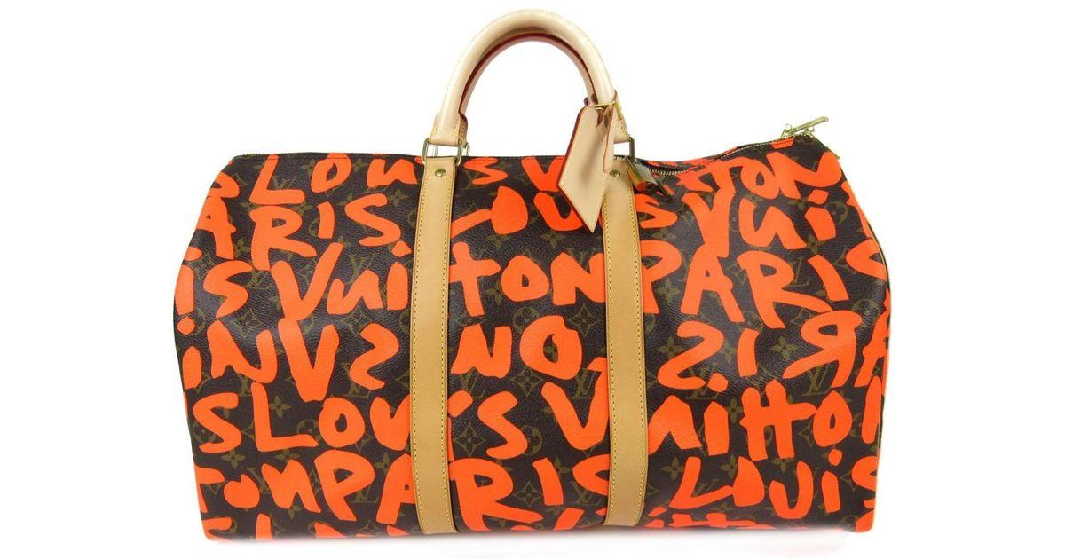 Lyst - Louis Vuitton Keepall 50 Boston Bag M93699 Monogram Graffiti Canvas  Orange in Orange 3a9c143769fdf