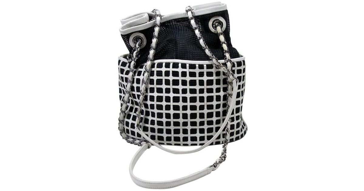 9521e6ff854a2f Chanel Edition Limited White Leather And Mesh Black Fabric Bucket Shoulder  Bag in Black - Lyst