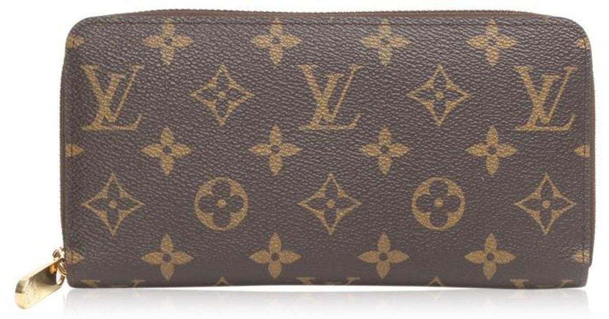 679cb319cdac Lyst - Louis Vuitton Monogram Fuchsia Zip Around Zippy Wallet M41895 in  Brown