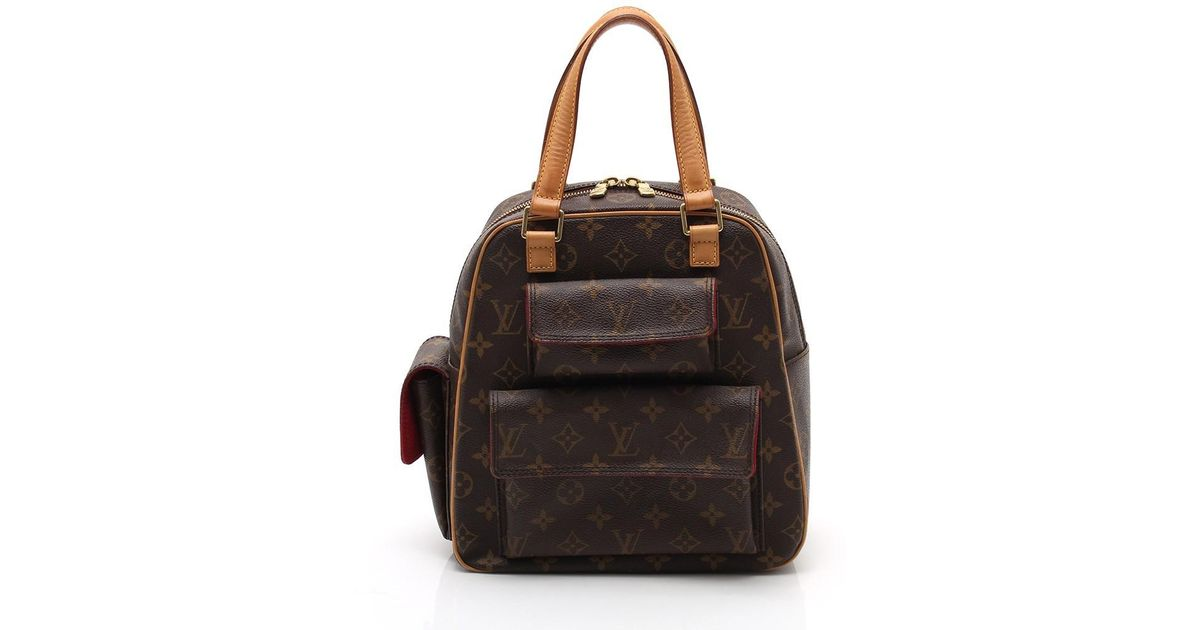 Lyst - Louis Vuitton Aix Suntory Cite Handbag Monogram Pvc Leather Tea in  Brown 4c40f26f0bc5