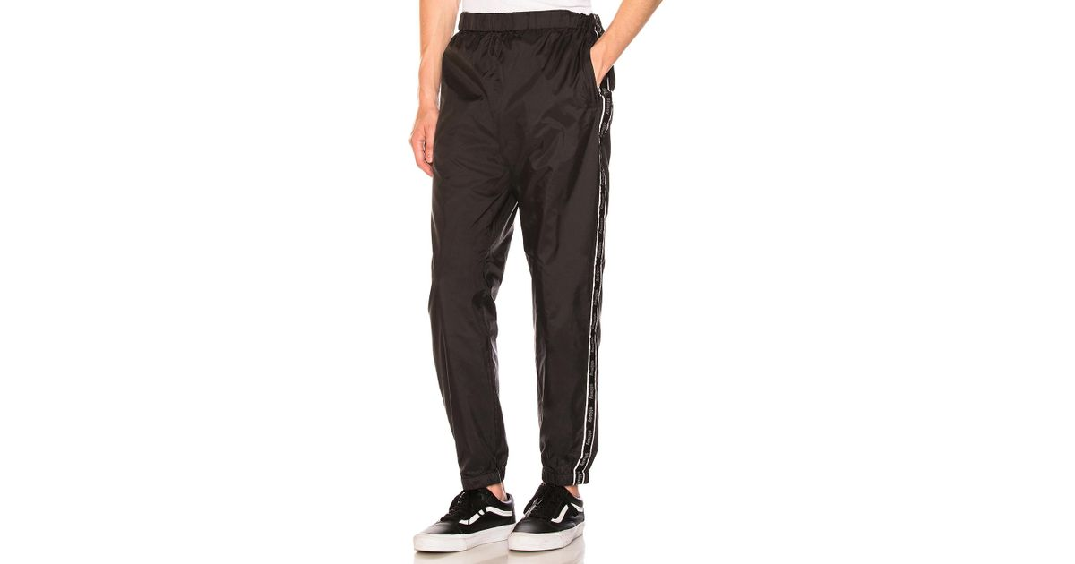 7b80ea5cf19bbd Stussy Nylon Warm Up Pant in Black for Men - Lyst