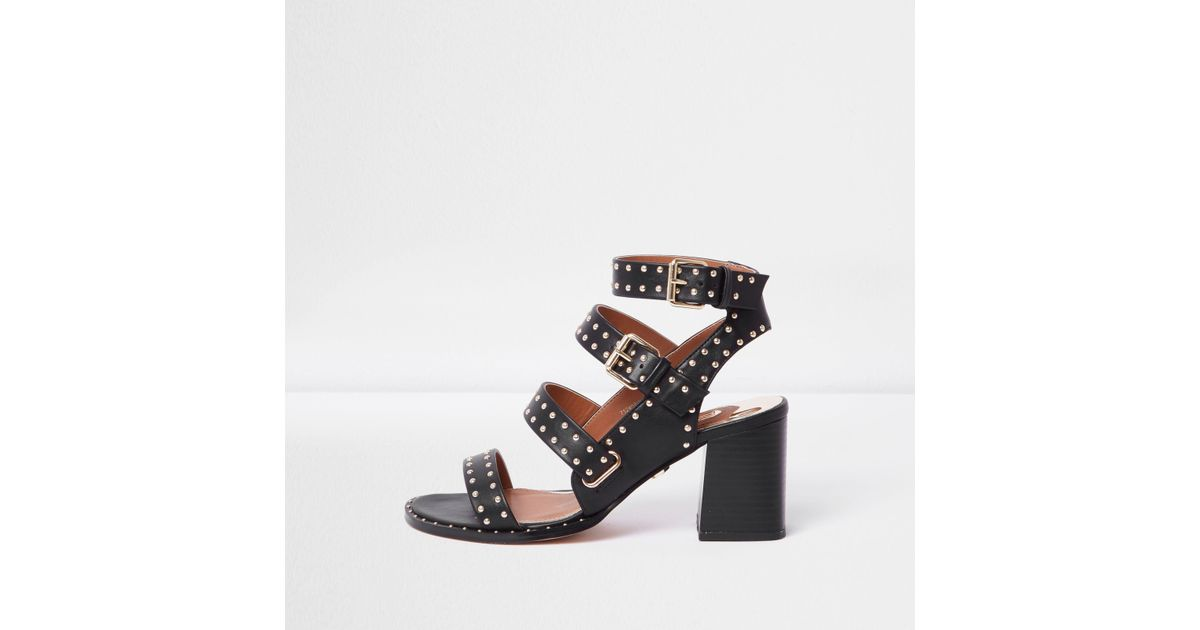 17c797a1f65 Lyst - River Island Black Studded Strappy Block Heel Sandals in Black