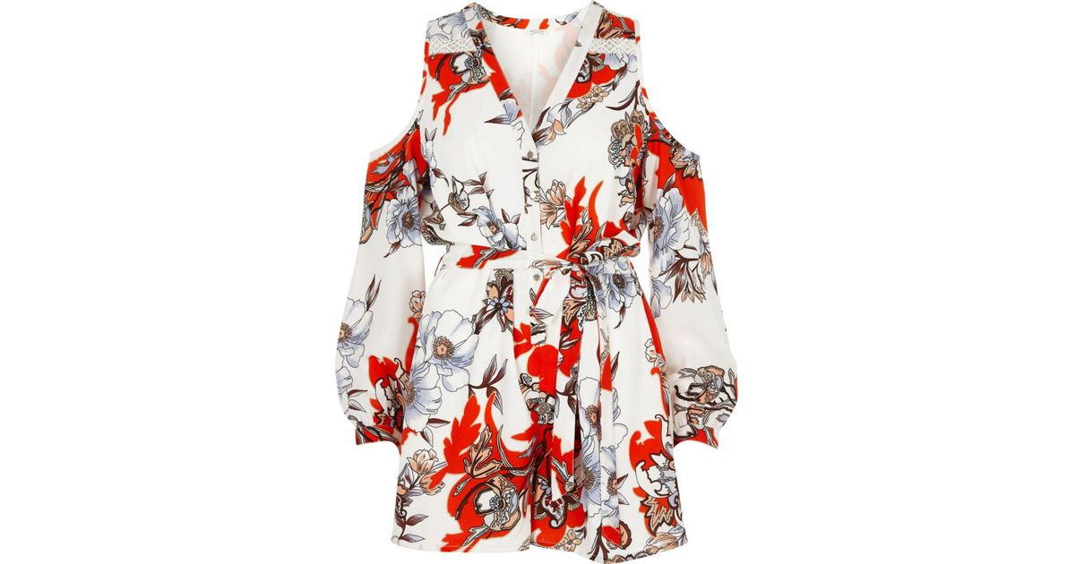 ce38455b80 Lyst - River Island Cream Floral Print Cold Shoulder Playsuit in Red