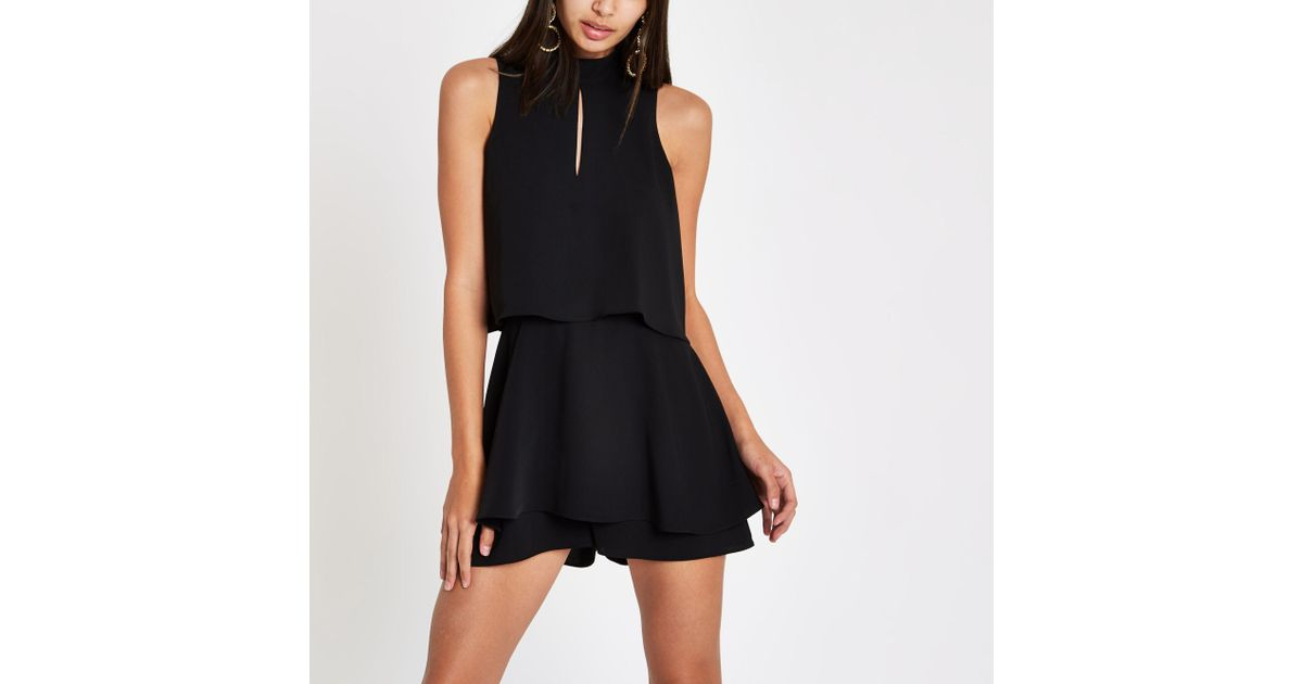 a19822f1a4 River Island Black High Neck Tiered Frill Playsuit in Black - Lyst