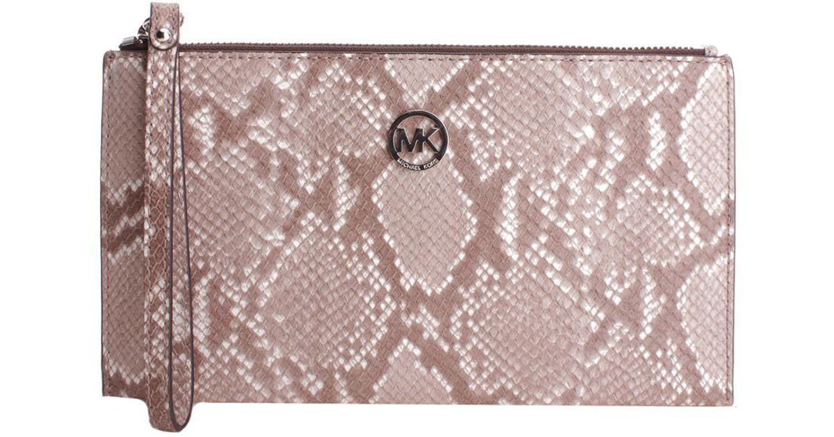 03d0a541a32bee Lyst - Michael Kors Fulton Large Zip Clutch in Pink