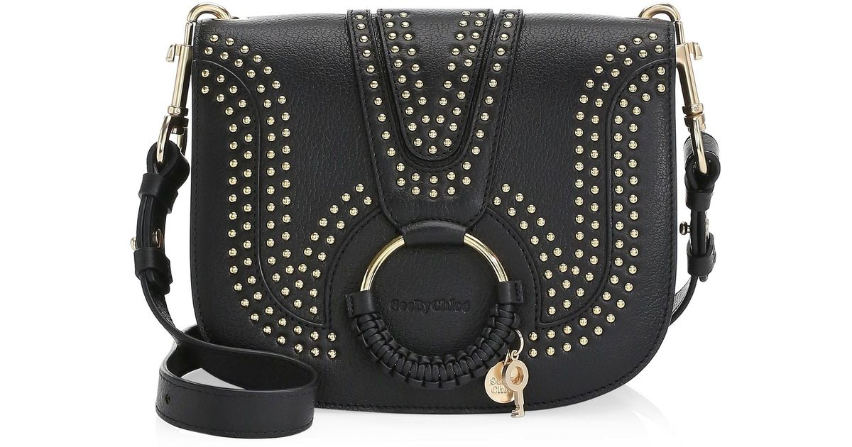 d12ea9278b4e Lyst - See By Chloé Hana Studded Leather Saddle Bag in Black