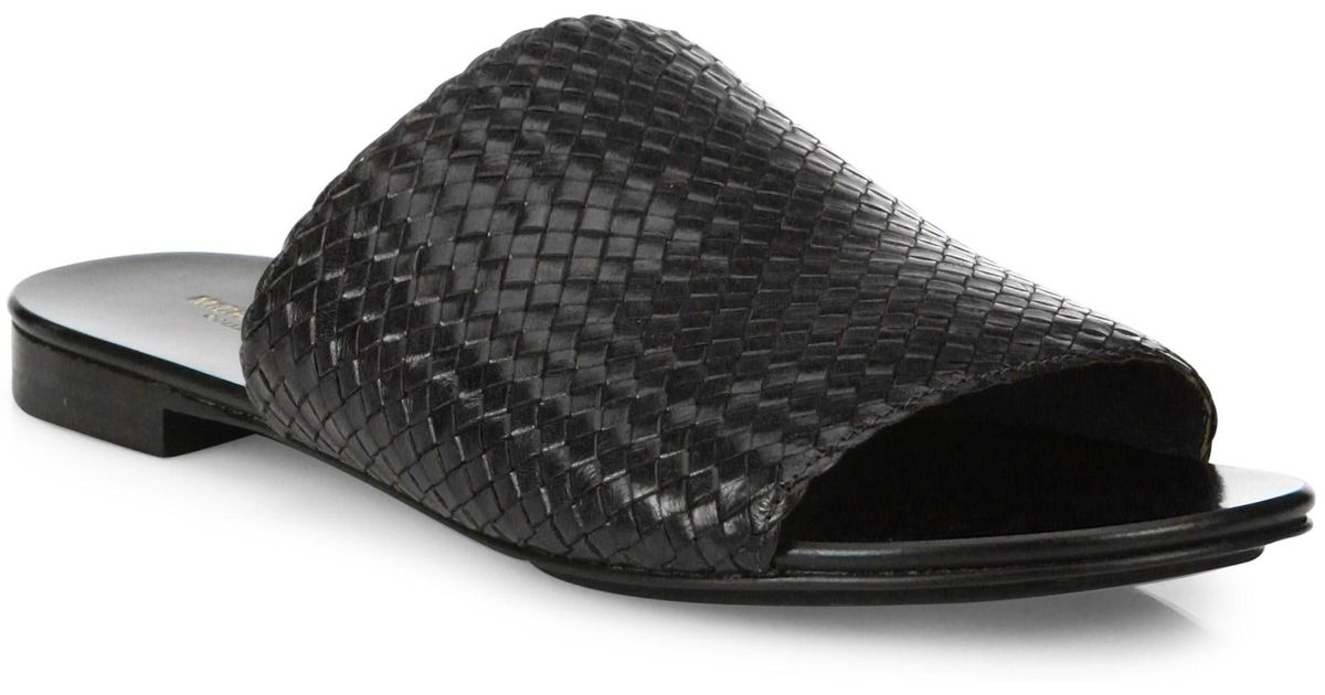 40a82930b16eaa Lyst - Michael Kors Byrne Woven Leather Slides in Black - Save 37%