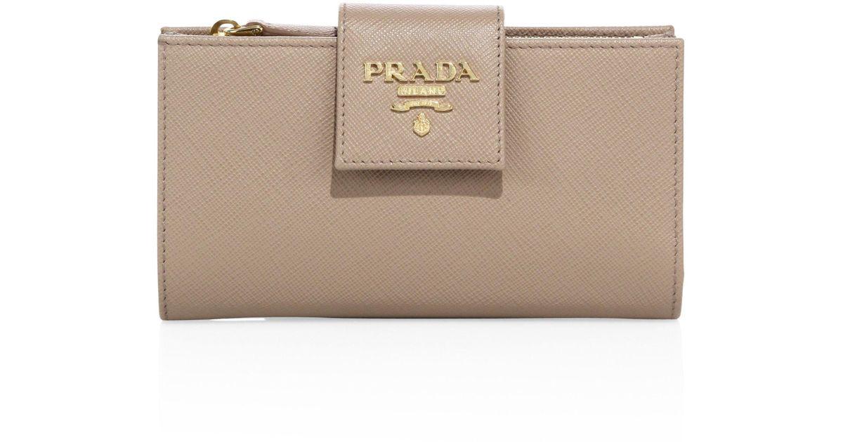c83a82e4196e norway prada saffiano triangle long flap wallet f86a0 e498e; inexpensive lyst  prada saffiano leather tab wallet in brown 005bb 1414b