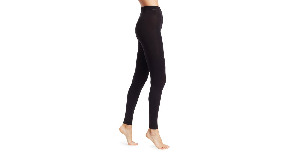 7f6a3fd1f8 Lyst - Donna Karan Matte Jersey Footless Tights in Black