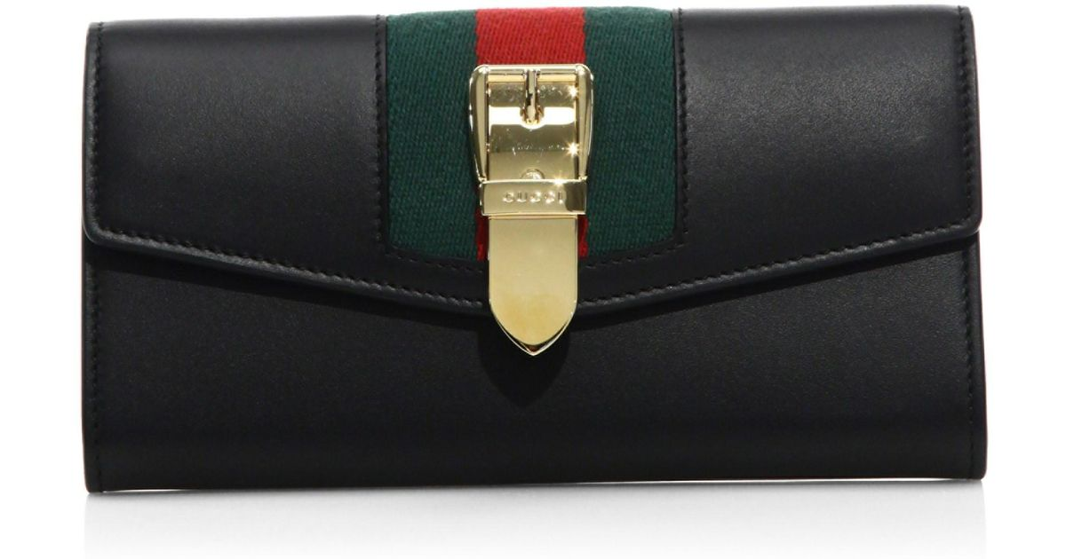 66171122d676 Lyst - Gucci Women's Sylvie Leather Flap Wallet - Hibiscus Red in Black