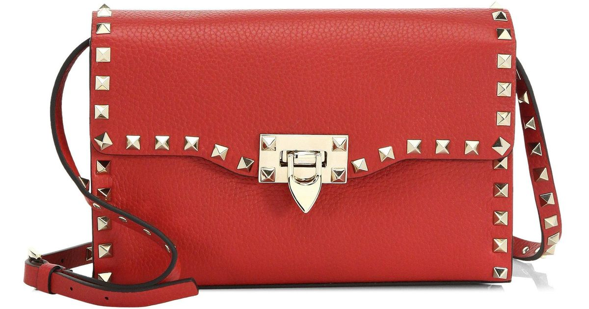 7dfebe29b7827 Lyst - Valentino Rockstud Medium Leather Crossbody Bag in Red