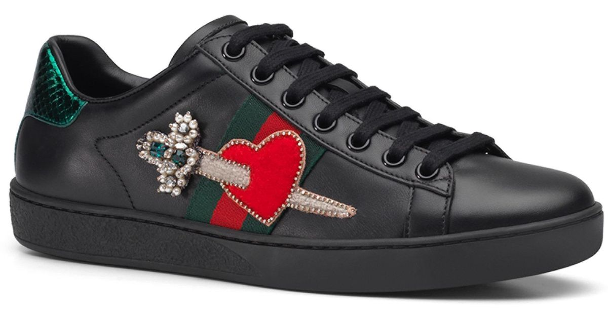 f72a15b3cc5 Lyst - Gucci New Ace Pierced Heart Leather Sneakers in Black