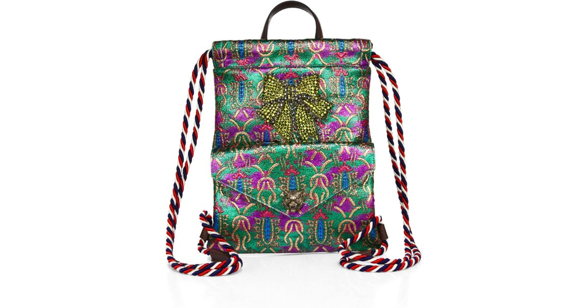 fd96423cc071 Gucci Metallic Jacquard Drawstring Mini Backpack in Green - Lyst