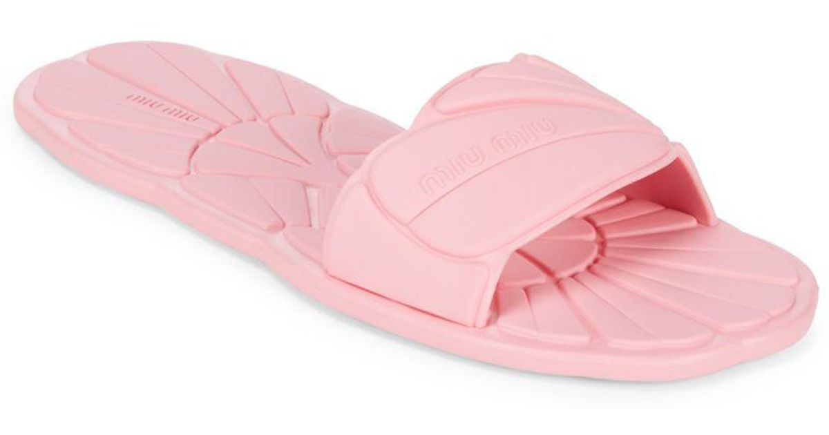 bbc6c59b51d6c9 Lyst - Miu Miu Rubber Slide Slippers in Pink