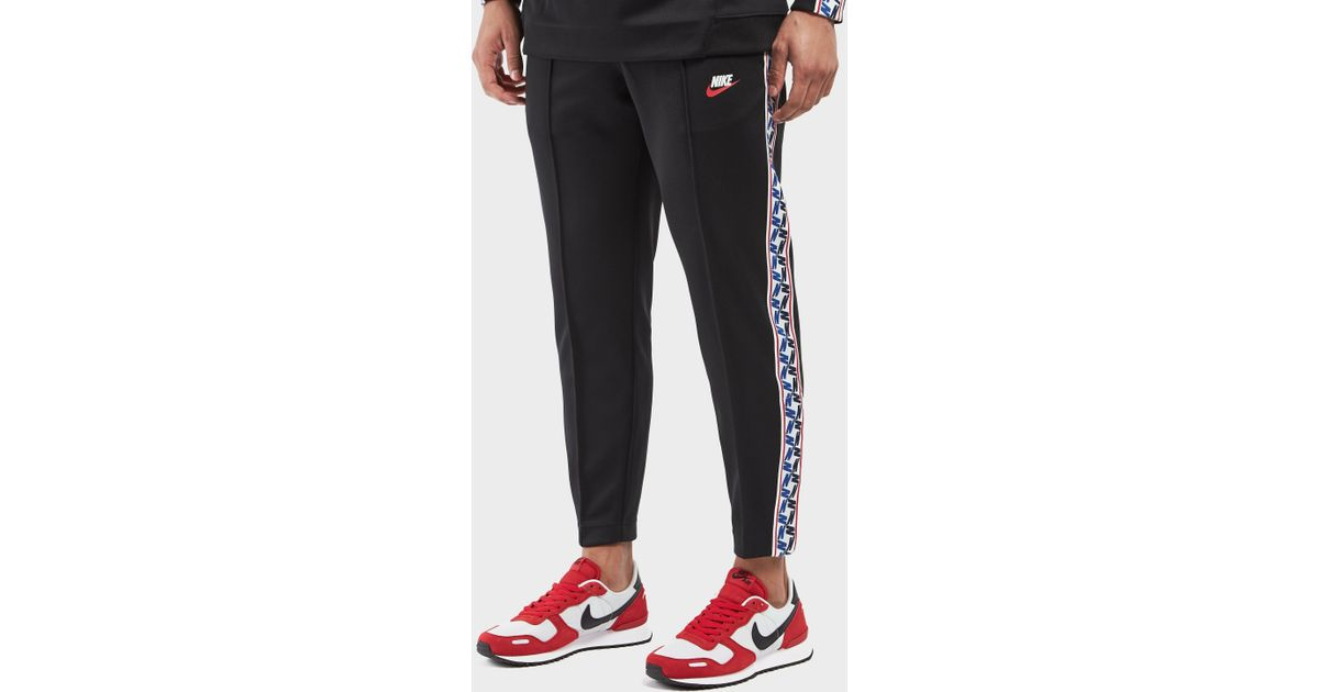 d3b9782a Nike Taped Poly Track Pants in Black for Men - Lyst