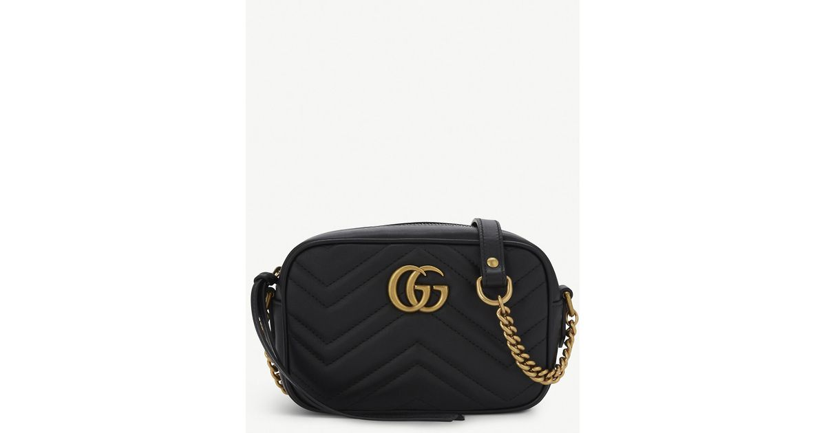 97568aa28 Gucci GG Marmont Mini Quilted Leather Cross-Body Bag in Black - Lyst