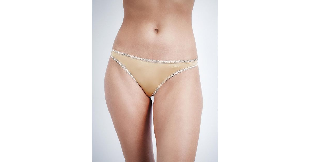 58a9399671c7 Lyst - Calvin Klein Seductive Comfort Jersey Thong in Natural