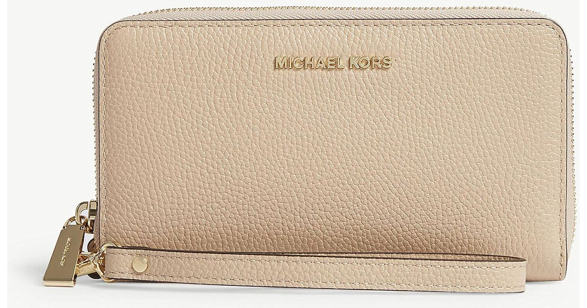 01c3aeb2cf34 Lyst - MICHAEL Michael Kors Mercer Large Grained Leather Multi-function  Wallet in Natural