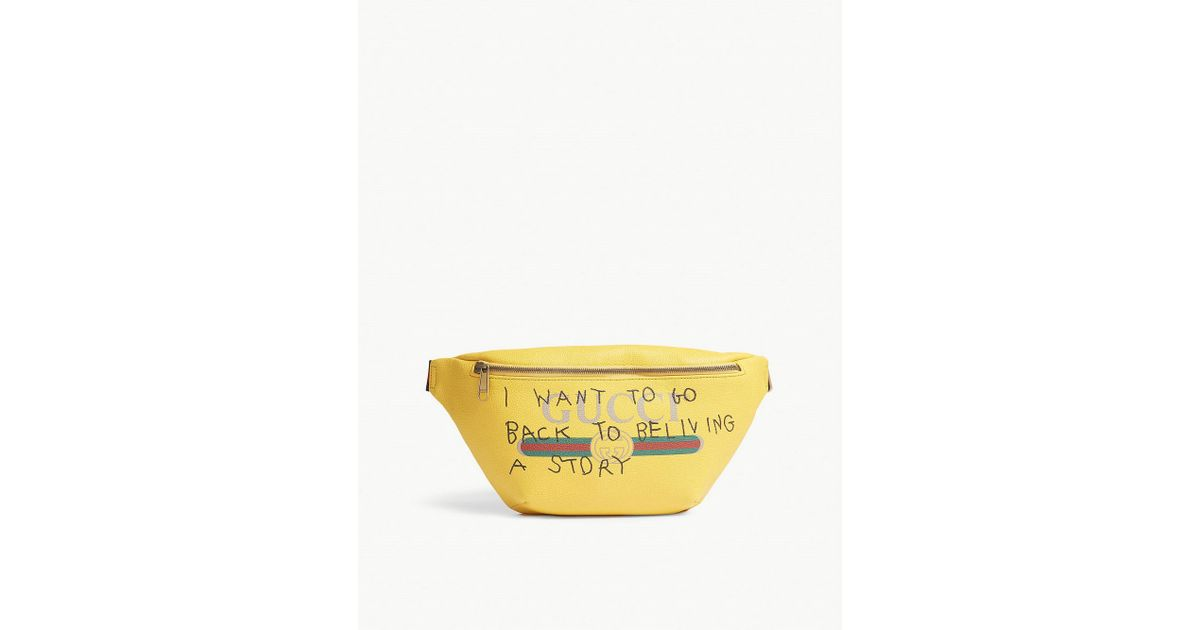2e3684bce95bc3 Gucci Quote Logo Grained Leather Bumbag in Yellow - Lyst