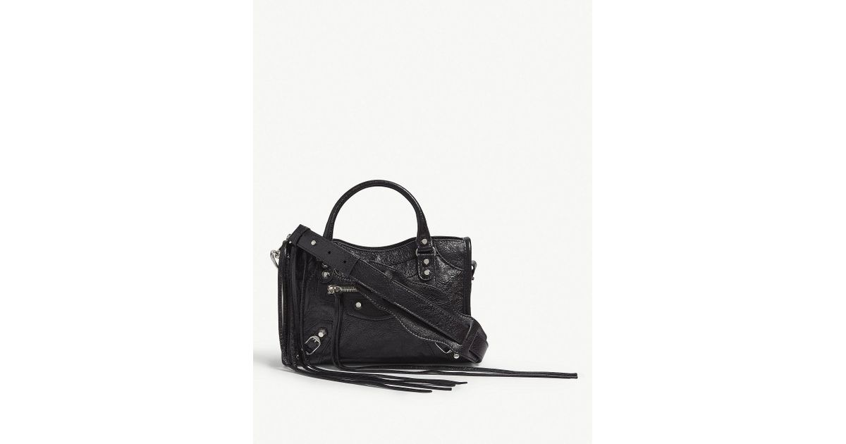 5958c9ba893 Balenciaga Mini City Lambskin Cross-body Bag in Black - Lyst