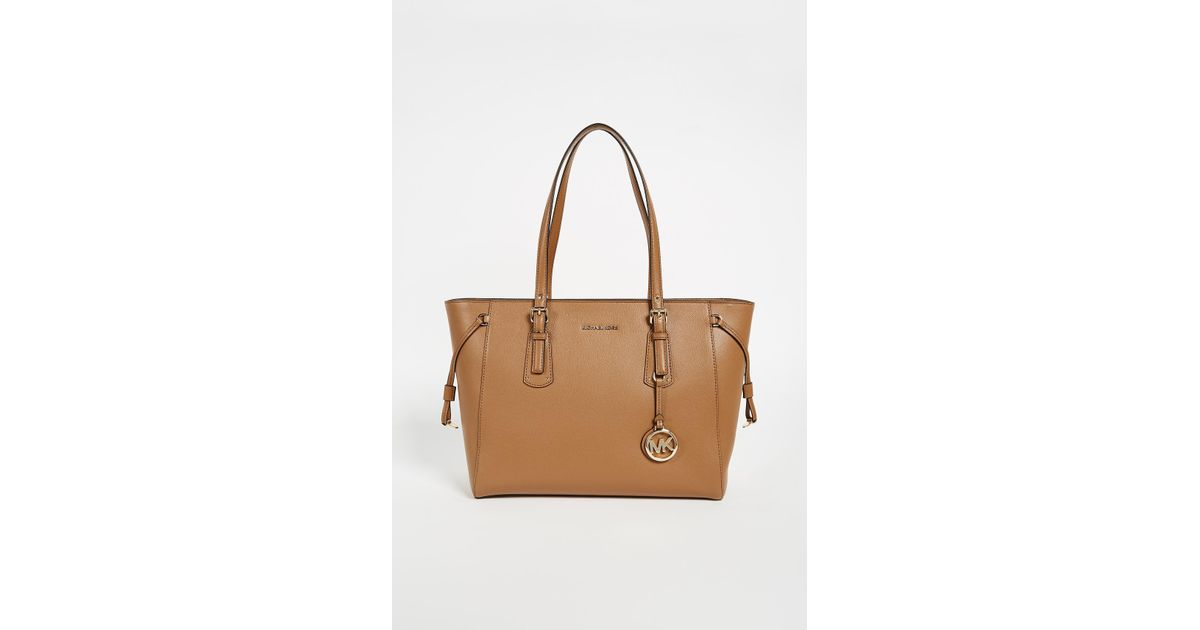 624016a8ce7 Lyst - MICHAEL Michael Kors Voyager Tote in Brown