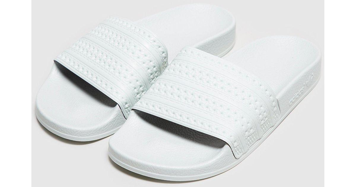 c804908b7798 Lyst - adidas Originals Adilette Slides Women s in White