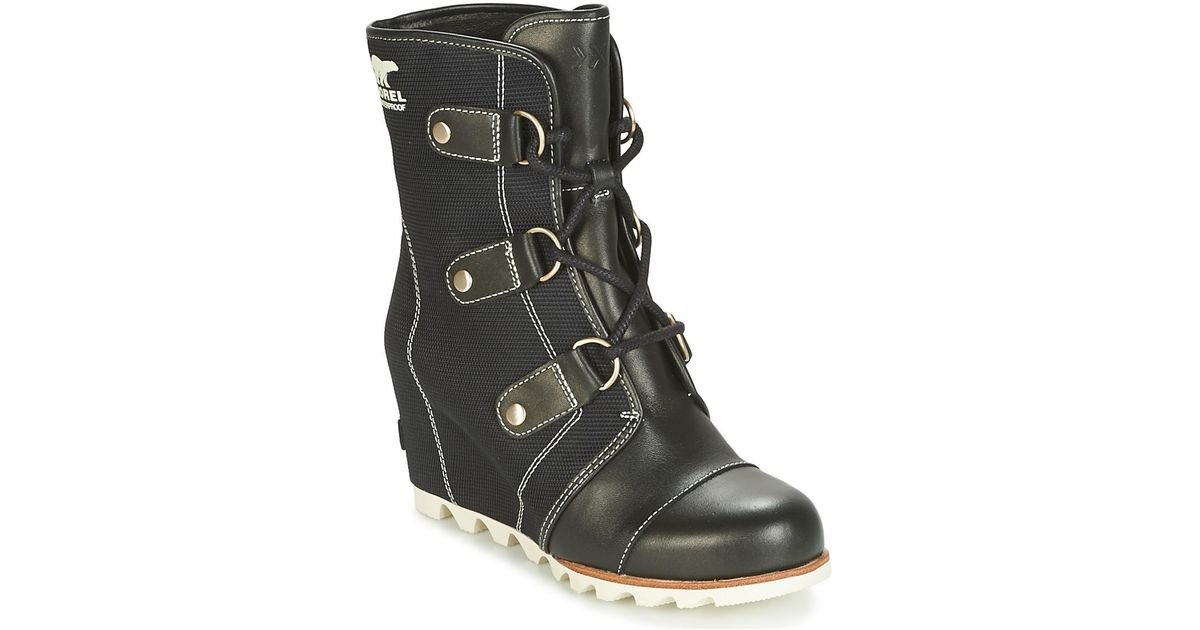 5148cd2aaa96 Sorel Joan Of Arctic Wedge Mid X Celebration Women s Snow Boots In Black in  Black - Lyst