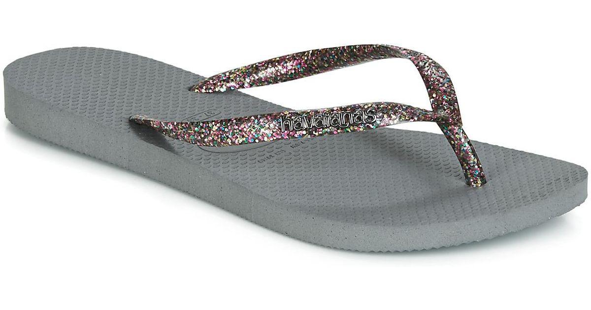 1cd86432e19995 Havaianas Slim Logo Metallic Women s Flip Flops   Sandals (shoes) In Grey  in Gray - Lyst