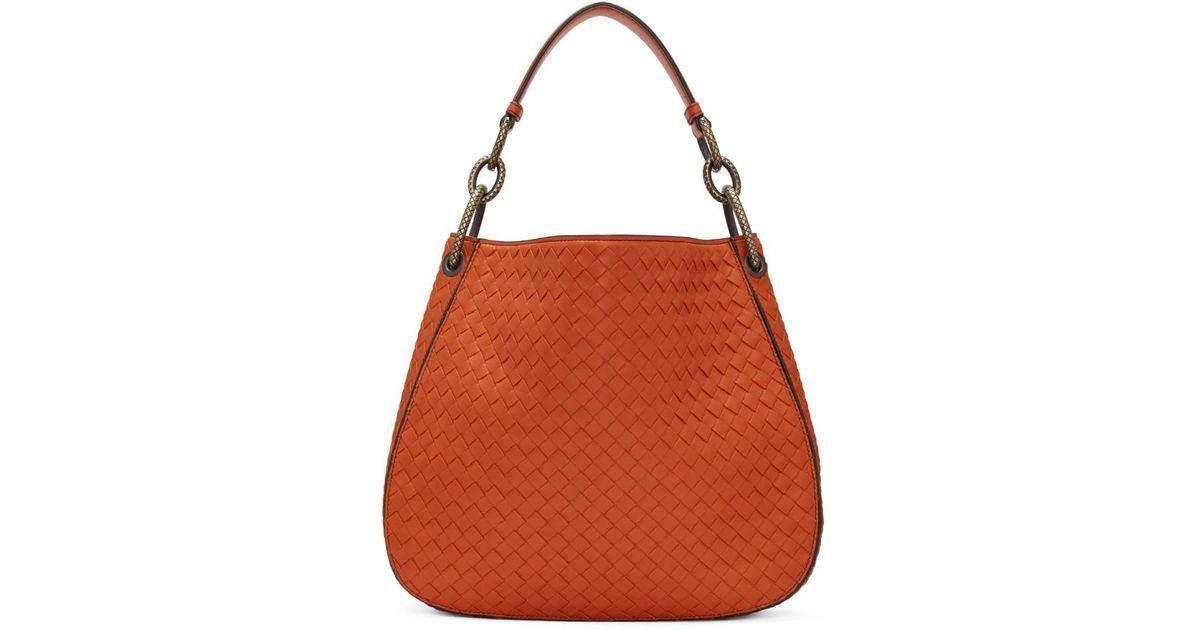 54cae910a5 Bottega Veneta Orange Small Intrecciato Hobo Bag in Orange - Lyst