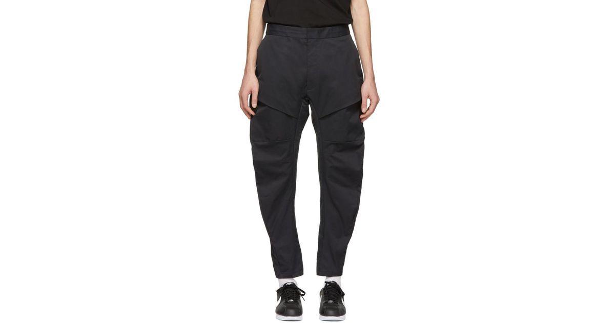 Lyst - Pantalon cargo tisse noir Tech Pack Nike pour homme en coloris Noir 7d641ad84059