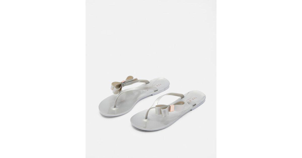 956d8ce20 Lyst - Ted Baker Bow Detail Jelly Flip Flops in Metallic