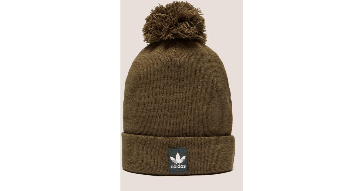 73fd4f35a47 ... uk lyst adidas originals mens logo bobble hat brown in brown for men  61736 b798a