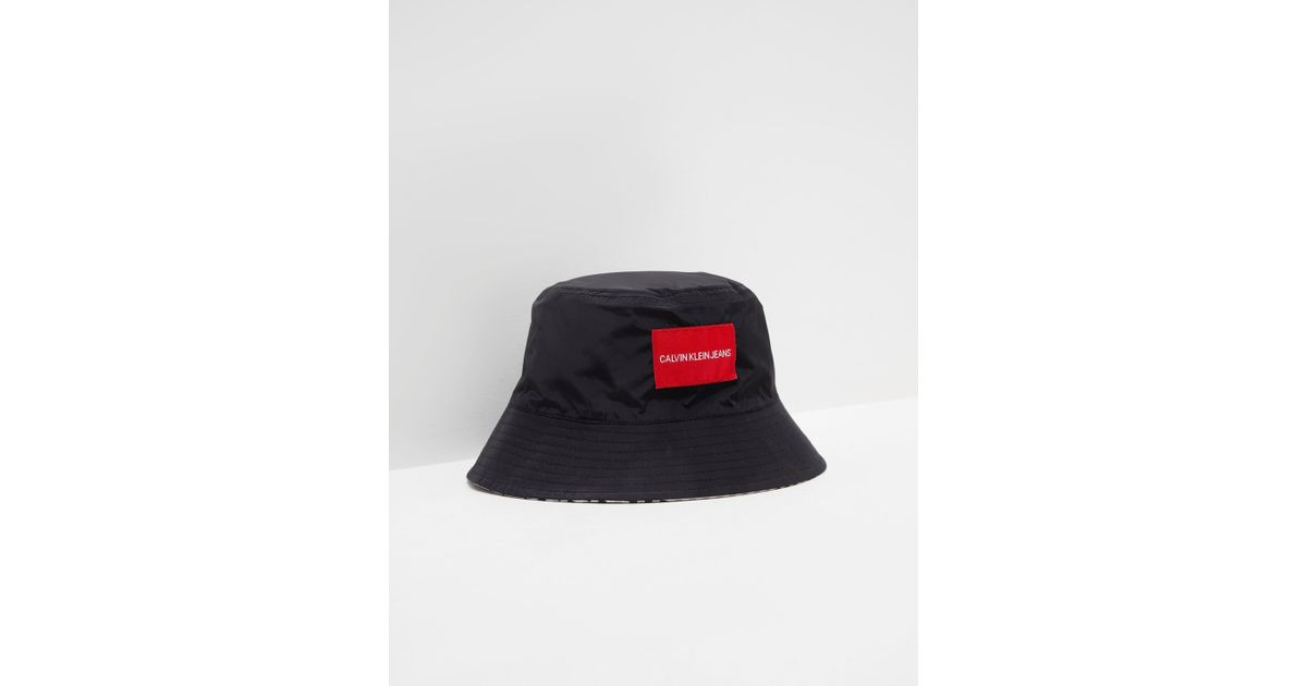 a779f44c Calvin Klein Womens Reversible Bucket Hat - Online Exclusive Black in Black  - Lyst