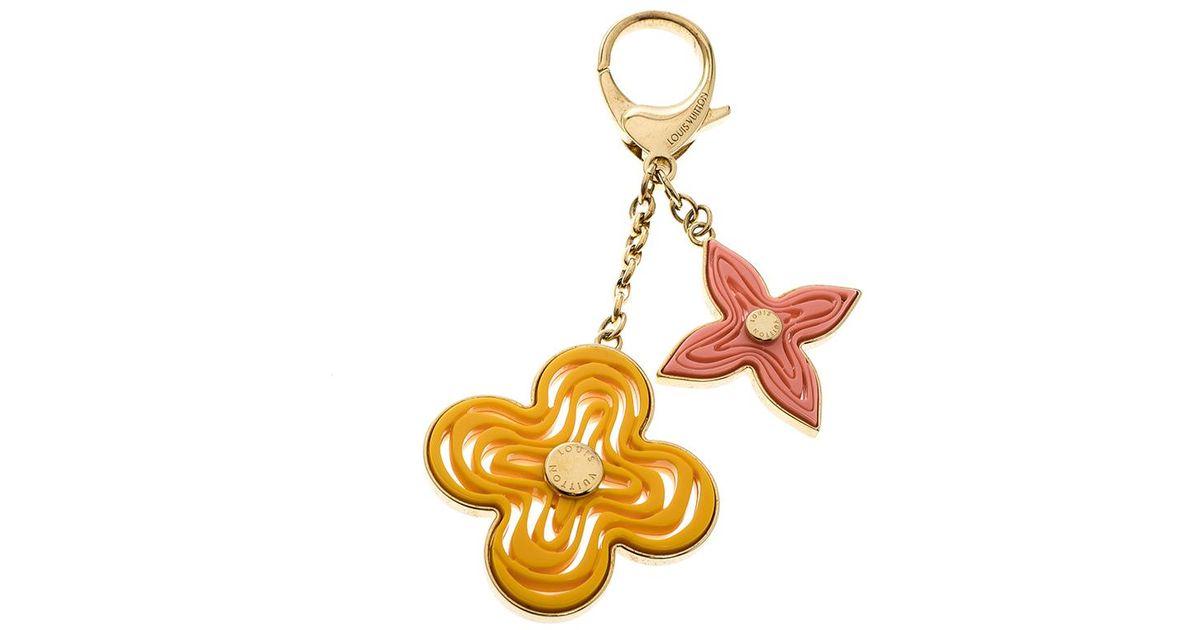 e7ae0cf0ead8 Lyst - Louis Vuitton Resin Gold Tone Naif Key Holder   Bag Charm in Metallic